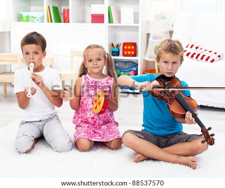 Our first band - Kids playing on musical instruments - stock photo