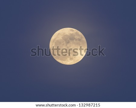 Our full moon in North Germany after sunset - stock photo