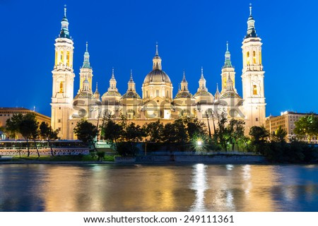 Our Lady of the Pillar Basilica with Ebro River at dusk Zaragoza, Spain - stock photo