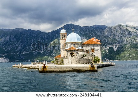 Our Lady of the Rock island and Church in Perast on shore of Boka Kotor bay (Boka Kotorska), Montenegro, Europe. Kotor Bay is a UNESCO World Heritage Site. - stock photo