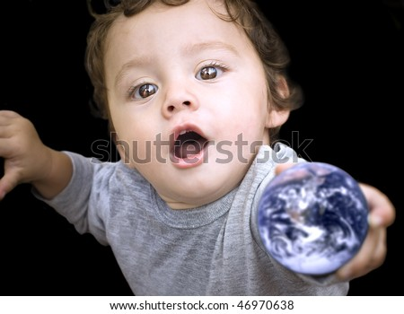 Our planet Earth in the hands of a child with love and magic in his eyes. - stock photo