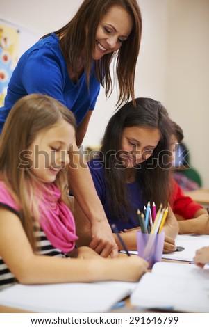 Our teacher is always very helpful - stock photo