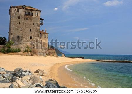 Ouranoupoli Tower on Athos peninsula, Chalkidiki, Greece  - stock photo