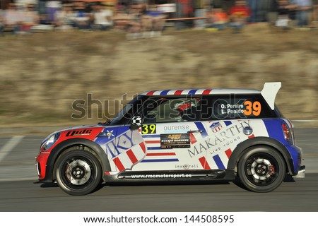 OURENSE, SPAIN - JUNE 14: Oscar Pereiro (exwinner Tour de France) and Luis Penido on board to BMW Mini Rallye N2 in 46 ourense rally 2013 - stock photo