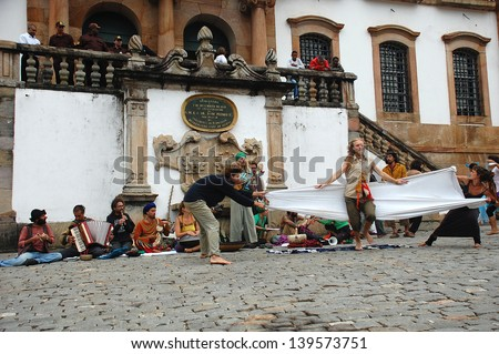 OURO PRETO, BRAZIL- MARCH 18 2012 :Members of  The Rainbow Family of Living Light  loosely affiliated group during a street exhibition in Ouro Preto, Minas Gerais ,Brazil    on 18 March 2012 .