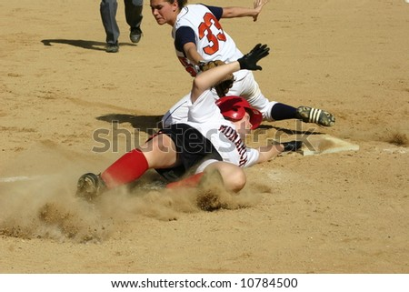 Out at third base, women's softball - stock photo