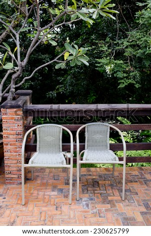 Out door couple of rattan chairs. - stock photo