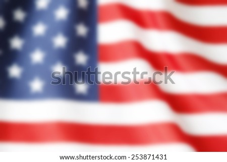 Out of focus American flag - stock photo