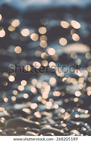 out of focus blur background with sea water in sunset light - retro vintage film effect - stock photo