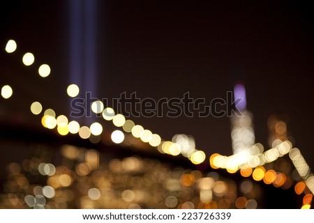 Out of focus Bokeh lights background of Brooklyn Bridge with the tribute in light at the back in New York City at September 11. - stock photo