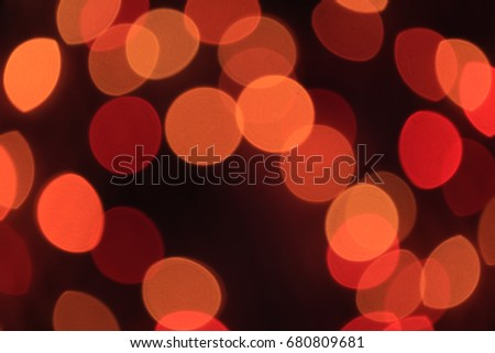 Out of focus, Defocused, Blurred, Bokeh of Red and Orange Color Light in the Dark for Abstract Background