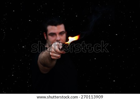 out of focus  fire eater over a starry night background - stock photo
