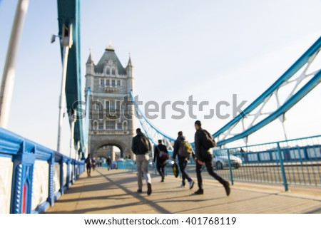 Out-of-focus image of unrecognisable pedestrians crossing Tower Bridge. - stock photo