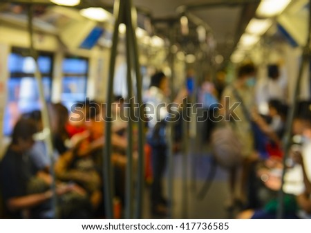 Out of focus inside subway train - stock photo
