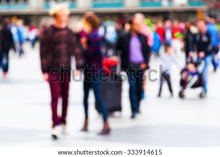 out of focus picture of people on the move in the city