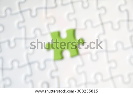 Out of focus puzzle with one puzzle missing