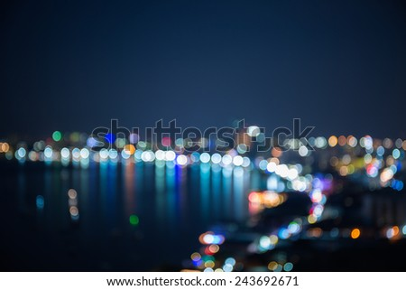 Out of focus sea bay and building in night time  - stock photo