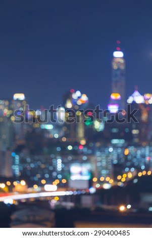 Out-of-focus shimmering lights night city background during twilight - stock photo