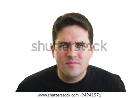 Out of focus, short sighted man squinting - stock photo