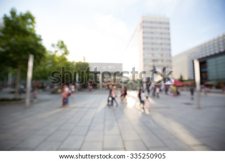 Out of focus shot of a shopping street in summer, people shopping - stock photo