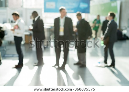 Out of focus shot of business people standing in line at a checkout - stock photo