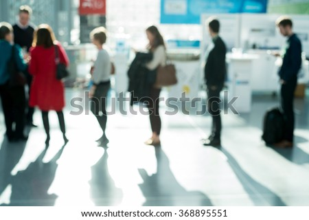 out of focus shot of people waiting in line - stock photo