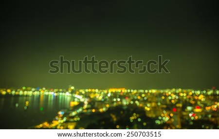 Out of focus to big coastal city in green tone - stock photo