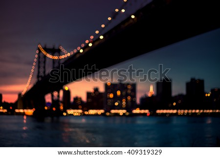 Out of focus view of Manhattan bridge at sunset. Manhattan New York. Urban living and transportation concept. Vintage color post processed - stock photo