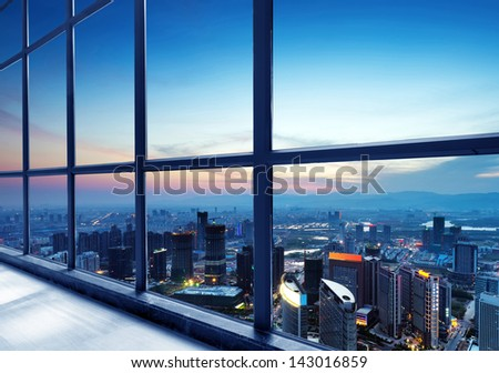 Out of the window of the big city at night - stock photo