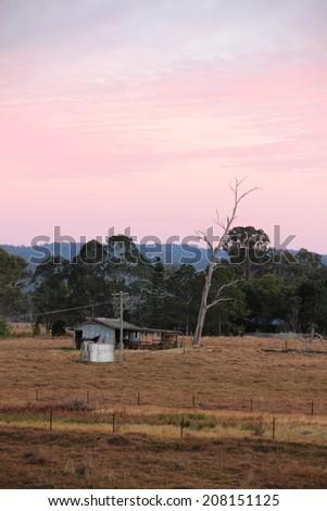 Outback australian farmland hut shed shack queensland - stock photo