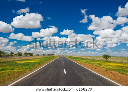 Outback highway stretching to the horizon (Barkly Hwy between Cloncurry and Winton, outback Queensland, Australia) - stock photo