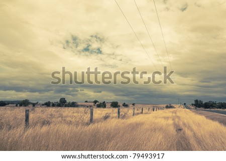 outback landscape with dramatic clouds - stock photo