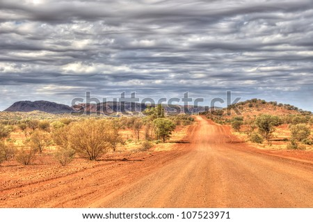 Outback Travel, Red Centre of Australia, dirt road near Hermannsburg/Alice Springs, Northern Territory, Australia - stock photo