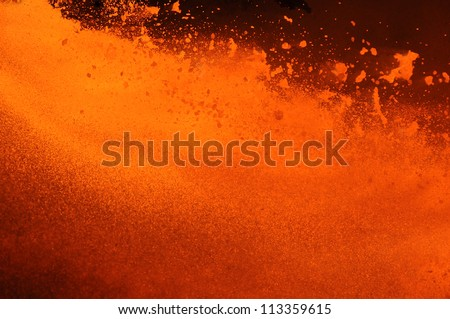 Outburst of boiling metal - stock photo