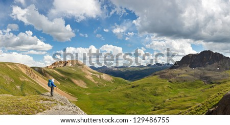 Outdoor Adventure Panorama. Hiker enjoys grand view of alpine tundra in Colorado, USA. - stock photo