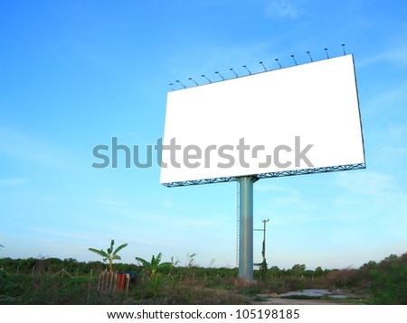 Outdoor advertising billboard on morning sky - stock photo