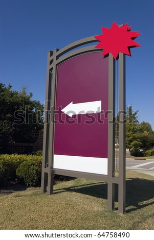 Outdoor advertising with white arrow and red star