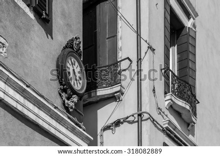 Outdoor analog wall street clock in Venice, Italy. Black and white photography. - stock photo