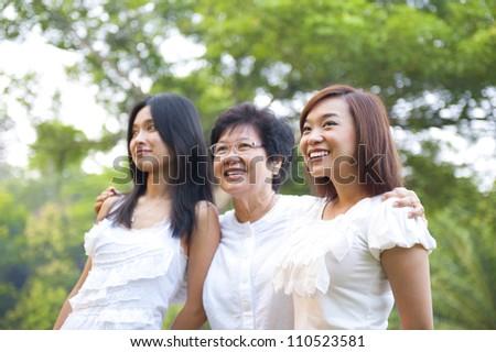 Outdoor Asian family having fun - stock photo