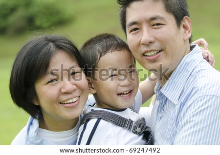 outdoor asian family portrait - stock photo