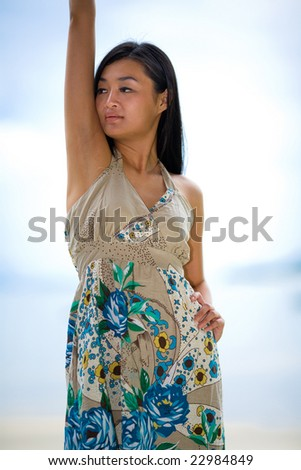 outdoor asian woman relaxing by the beach