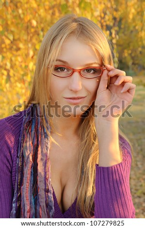 Outdoor autumn  portrait of modern  beautiful girl with scarf and glasses - stock photo