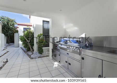 Outdoor barbeque area in modern house - stock photo