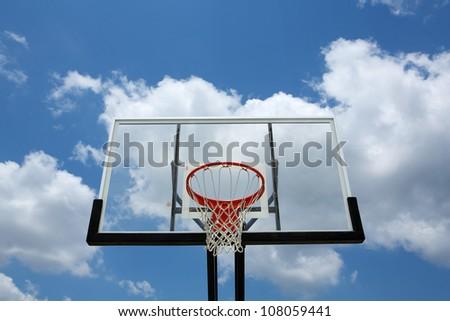Outdoor Basketball Hoop against a cloudy sky - stock photo