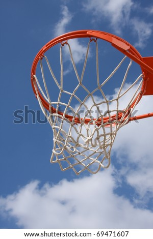 Outdoor Basketball Hoop against a cloudy sky