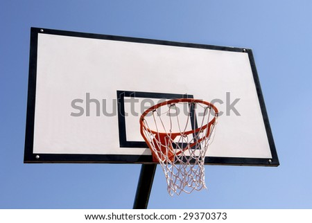 Outdoor basketball hoop against the blue sky - stock photo