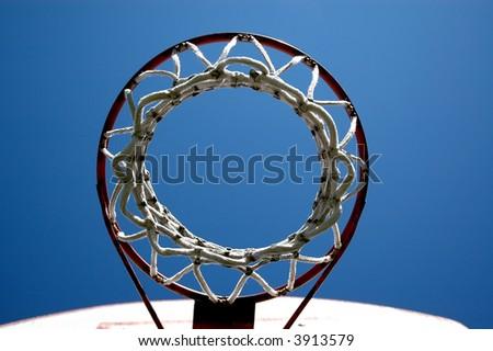 Outdoor basketball hoop/sky - stock photo