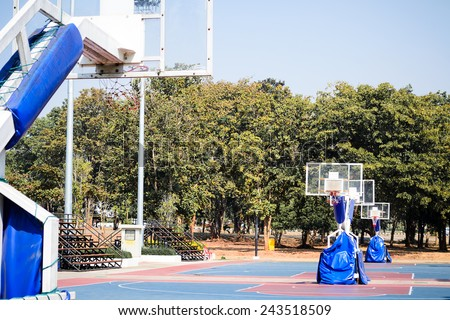 Outdoor basketball Stadium and sport light with blue sky - stock photo
