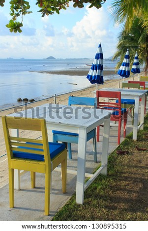 outdoor beach restaurant at tropical resort. - stock photo