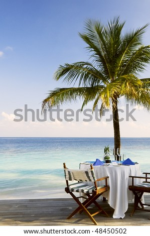 Outdoor beach restaurant at tropical resort. Space for text.